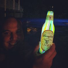 glowsticks in beer bottles... a cool summer night decoration!