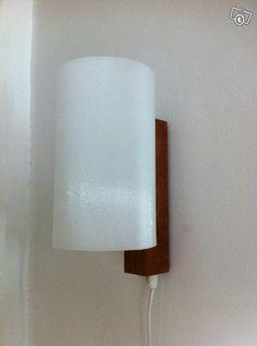 Teak/acrylic wall light by Itsu.