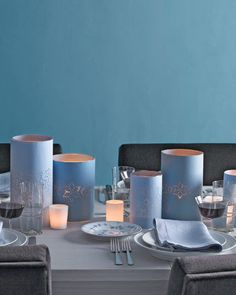 Hanukkah DIY - Make these Hurricane Vases and votive candle holders wrapped in star-punched paper -- an easy way to suffuse your party with warmth. Hanukkah Crafts, Christmas Table Decorations, Decoration Table, Hannukah, Happy Hanukkah, Hanukkah 2019, Hanukkah Celebration, Jewish Crafts, Hanukkah Food