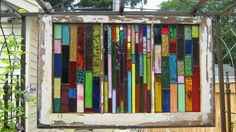 Handmade Suncatcher stained glass panels in Salvaged Wood Window BOUNTY OF COLOR. $333.00, via Etsy.