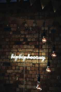 We love this neon light from this stylish industrial Auckland wedding. Photo by A Couple of Night Owls.