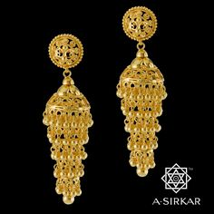 Bareilly Jhumka : Chandeliers in many guises will decorate the pandals during the Pujas. To that we add our own, with the disclaimer that ours is not an extraordinary ornament, merely a rather dramatic one. This five-tier cascade jhumka, handcrafted in bright yellow 22K gold, is classic in shape and shorn of intricate detailing. Much like a crystal wedding-cake chandelier, it's the drama of the form that makes it so compelling, so elegant and grand.