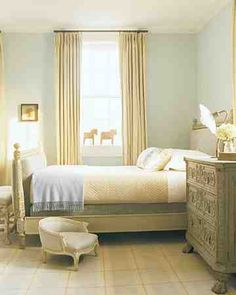 In a young girl's room in Sag Harbor, New York, a 19th-century bed has been reupholstered in a heavy velvet. The French 19th-century chair gives the family dog, Magic, easy access to the bed. Even the toy horses have provenance: They are Dala horses, a traditional motif of Dalarna, Sweden. The carved chest is German.