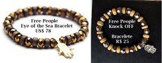 Inspirado no bracelete Eye of the Sea da Loja Free People que custa US$78 (equivalente a 300 reais) <br> <br>Bracelete com elasticidade, para facilmente se adaptar a seu pulso. Feito em madeira e contas com o pingente do símbolo Hamsá