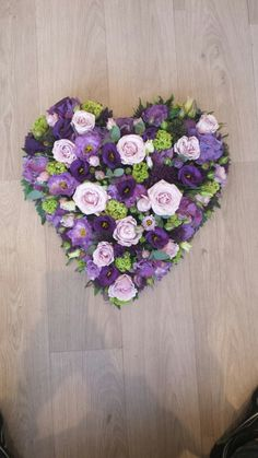 Lilac and purple loose full heart funeral flowers