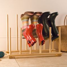 Neat Feet Boot Rack for £35. This wooden boot holder will keep wellies and outdoor shoes in order; it makes it harder for the spiders too!  Holds six pairs of boots for all the family.
