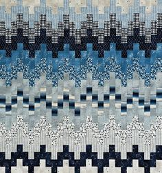 A range of blues and grays, gradating from light to dark, produce the look of waves on a stormy night. Pairing blue with gray instead of white puts a twist on the classic two-color combination. Fabrics are from the Nocturne collection by Janet Clare for Moda Fabrics [1]. [1] http://modafabrics.com