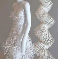 Pucci mannequins in paper dresses.fashion couture intricate lace paper cut art fashion installation collection