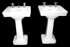 Petite porcelain pedestal sinks for the 2 bathrooms