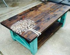 Beautiful coffee table. The post said it was made from pallets but I'm not so sure of that. The pieces on top are varying widths. I can see where it may be made from scrap wood though. I personally would love to see a tree that is similar to the tree of life, still off center but larger and with the tree branches reaching across the entire table.
