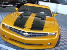 2010 Chevrolet Camaro, make the yellow black and the black red or pink or purple and thats my car!