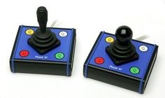 The PointIt! Joystick is a four-button USB joystick with the option to have three different tops. The base has four buttons on it for left click, right click, double click and pointer speed, and there are switch inputs for replacing the left and right click buttons.