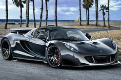 OMG.....sexxxxxyyyyyy.....Its the 2013 Hennessey Venom GT. It has a Lotus Elise body and a 1200 horsepower Chevy Corvette engine complete with 2 turbochargers. She goes 0-60 in 2.5 seconds.....i'm at a complete loss for words right now