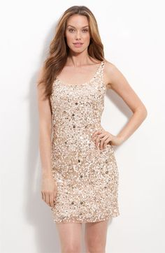 Pisarro Nights Short Sequin Sheath Dress  Multicolored sequins in a variety of sizes lend sparkling dimension to a short, sleeveless mesh dress with a gracefully scooped front and back neckline. $158 at Nordstroms.com