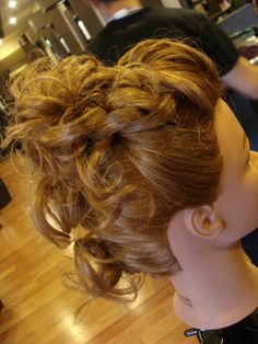 Modern mohawk updo - could be good for long curly hair