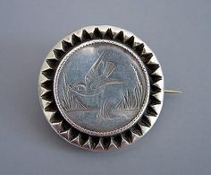 VICTORIAN silver round brooch with engraved bird motif,