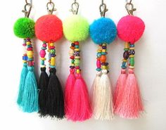 Luisa Tasselled Keychain Trio of Long Silky Tassels Large Handmade Wool Pom Pom Beadwork Bag Charm Trio Tassel Keyring Gift For Her Featuring handmade fluffy wool pom pom complete with wood and glass colored beadwork and a trio of 4 silky luxe tassels,complete with brass clasp. Total