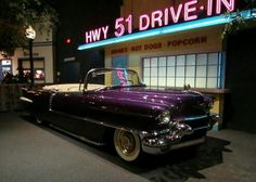 Elvis' 1956 Cadillac Eldorado Convertible, When looking at the new caddy in 1956 Elvis Presley when to the salesman to order one and told him he wanted one but he wanted it the color purple, when the salesman question him about the color showing Elvis a custom paint chip catalog, Elvis aaid No No let me show you he took some grapes from a bag that he was snacking from and squish them on the hood of the car and said look see this is the color I want! When the dealer delivered the car to Elvis…