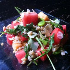Watermelon and Barley salad with Fava beans, cantaloupe, shaved Parmesan, wild arugula and rosemary vinaigrette from Social Kitchen and Brewery in San Francisco, CA.