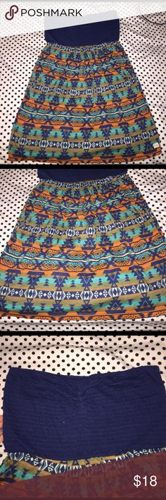 Billabong dress Billabong dress never worn. comes to knee length! it's a halter, has no straps. navy blue top with tribal print bottom Billabong Dresses Mini