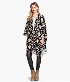 Black & white poncho with fringe & geometric jacquard knit design.│ H&M Divided
