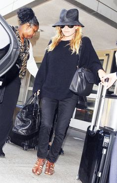 Mary-Kate #Olsen donned a #TheRow black cashmere sweater at LAX this weekend. #airportstyle. Click to shop!