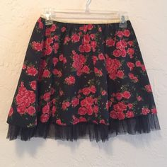 Rue 21 Floral and Tulle Mini Skirt Adorable lightweight mini skirt with floral design. Design is black with red, pink, and green flowers. Elastic waistband. Rue 21 Skirts Mini