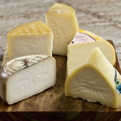 Spanish Cheese Sampler Board: 1 lb cut portion, Romao 1 lb cut portion, Garrotxa 1 lb cut portion, Manchego - Aged 6 Months 1 lb, Mahon DO - 4 months 1.75 lb, Tetilla Campobello