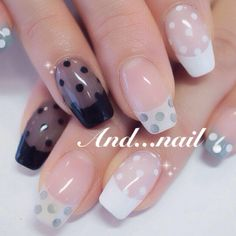 black french tips with black tinted base and polka dots
