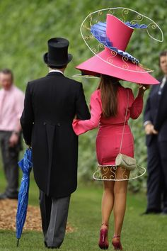 "Now that's quite a hat...must be either at Ascot or the Kentucky Derby. I'd ""bet"" on the latter.  No wonder she's trying to balance it with her free hand!  This may be a little TOO MUCH!"