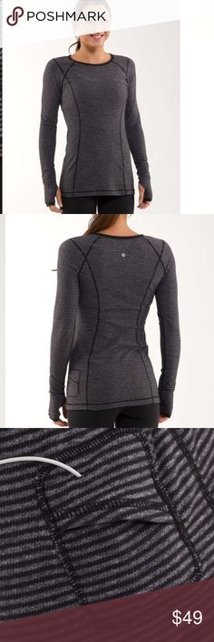 Lululemon turn around long sleeve In GOOD CONDITION NO STAINS NO HOLES! Made of super soft Rulu this crew neck long sleeve (LS) tee is reversible and intentionally long in length, which makes it perfect for layering over running tights. reversible as is our mood thumbholes mean sleeve stay put and wrists stay warm can be worn on its own or as a base layer in cooler temps long length covers your rear and is great for layering over running tights pack your key, card in the discreet side pocket…