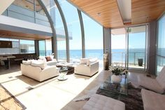 This was the beach house used in 'Sex in the City' Movie (Samantha's place!)...Yet that isn't why I have fallen in love with it -- it's the view; it's the rounded roof, arching over; why isn't there more buildings with gorgeous curves?? <3 It's all the glass...and did I mention the view?!!