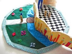 """Castle playmat, 23""""   Mat draws closed with cotton drawstring and transforms into a handy carrying sack for storage when play is done or on the move."""