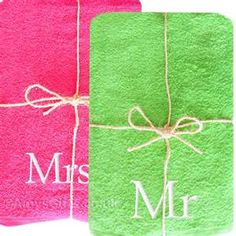 """Embroidered pink and green """"His and Hers"""" towels"""