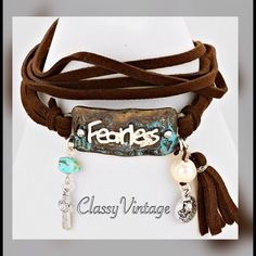 "Dark brown faux leather "" fearless""  bracelet. Dark brow and metal tag that says ""fearless"" . 22 inches long and 2 inch extender. Jewelry Bracelets"