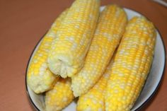 6-8 ears corn, husks and silk removed water 1 1/4 cup milk 1/3 cup brown sugar 1/4 cup butter (optional and to add to the water) bring to boil.  boil for 7 to 8 minutes