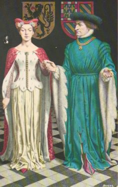 She:Pellote with fur ermine; he:houppelande with dagged sleeves.  In 1369 married Margaret of Male with the Duke of Burgundy, Philip the Bold. On the death of Louis de Maele in1384, she inherited the county of Flanders.