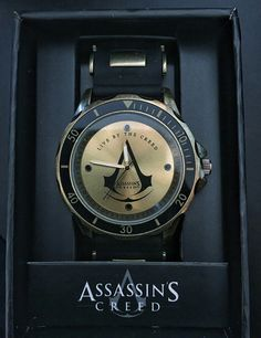 "Assassin Creed Watch - In the middle it says ""Live the Creed"" 