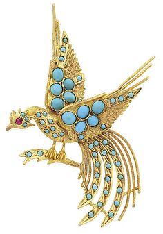 A TURQUOISE BIRD BROOCH The finely detailed bird, set with turquoise and ruby set eye, in 14k gold.