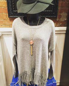Perfect shade of grey!! Grey sweater with fringe- $39.95 Grey floppy hat- $24.95 Pink stone statement necklace- $24.95  #madisonsbluebrick #fringe #fallfashion #sweater #floppyhat #downtownhotsprings #shoplocal