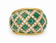 AN EMERALD AND DIAMOND RING, BY ASPREY