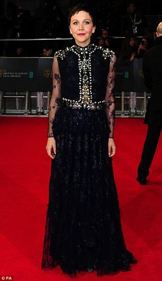 actress Maggie Gyllenhaal opted for a striking full-length lace gown and dark pixie crop