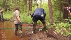 Two Guys in Green Rubber Thigh Waders Muddy 4x4