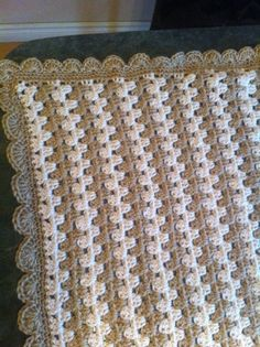 First ever Crochet Project, learned crochet on Crochet Guru Youtube channel, then first project 2 days later was this baby blanket using Red Heart Soft Wheat and Off White with 6.0mm hook. Easy beginner blanket can be completed in 2 to 3 weeks. Free pattern http://www.maybematilda.com/2014/02/granny-stripe-baby-blanket-tutorial.html