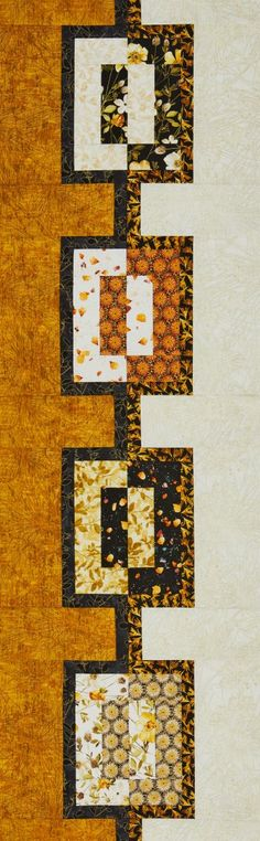 Metallic gold accents shimmer in a quilt that can be hung on a wall or displayed on a table.