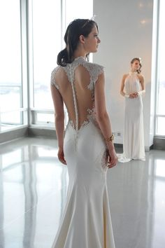 This fitted gown with lace and button details is SO stunning from behind. From the Galia Lahav spring 2015 bridal collection.