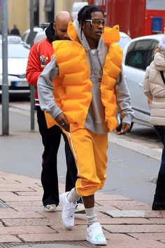 ASAP Rocky wearing Gucci Hooded cotton sweatshirt with Gucci print, Gucci Wool blend socks with bee, Nike Custom Trouble Andrew x Air Force 1 Low Sneakers, Gucci SS17 Joggers, Balenciaga SS 17 Puffer Gilet