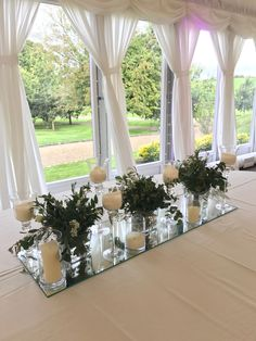 Wedding Top Table Floral Arrangement on a Mirror Base