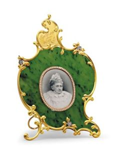 A JEWELED GOLD-MOUNTED NEPHRITE PHOTOGRAPH FRAME MARKED FABERGÉ, MOSCOW, CIRCA 1898;  sold 245,000 USD;  CHRISTIES 6/22/2016.