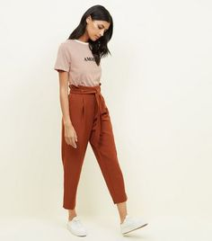 11 Brown Trousers Outfit Even back the apple is in chaos, there's no endlessly Nikita Dragun from demography allotment in her best admired activity: cutting thongs in public. Trousers Women Outfit, Brown Pants Outfit, Trouser Outfits, Pants For Women, Clothes For Women, Paperbag Hose, Paperbag Pants, Tie Waist Trousers, Bandeau Outfit